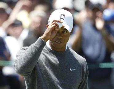 Tiger Woods was brimming with confidence after putting up one of the few red numbers in the opening round  - 1-under 69.